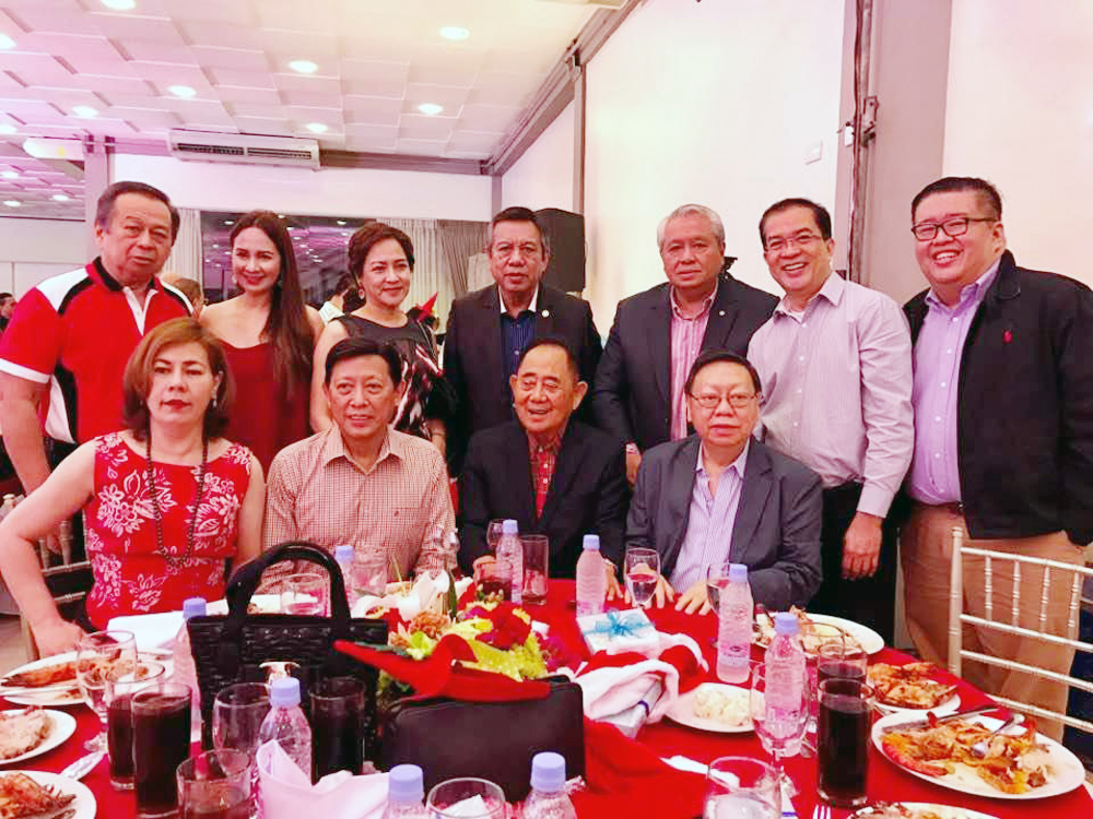 Dr. Albert S. Alday together with the members of the Rotary Club of Manila