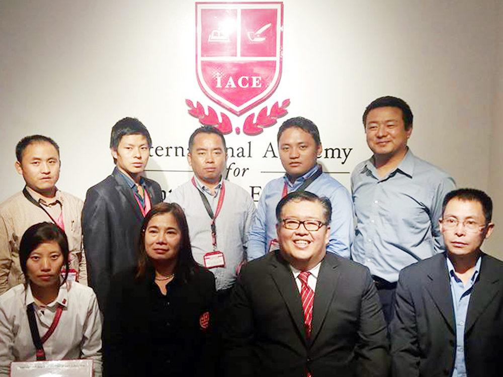 IACE CEO Ms. Susana B. Balanay and President Dr. Albert S. Alday together with MoEA's Hydromet Division during the Awarding of Certificate held in IACE (Standing from L-R Mr. Ngawang Namgyal, Mr. Jai Ram, Mr. Tashi Tenzin, Mr. Tshewang Rinzin, and Mr.Pema Wangdi) (Sitting L-R Ms Sangay Choden, IACE CEO Susana Balanay, IACE President Albert Alday and Chief Mr. Karma Dupchu)