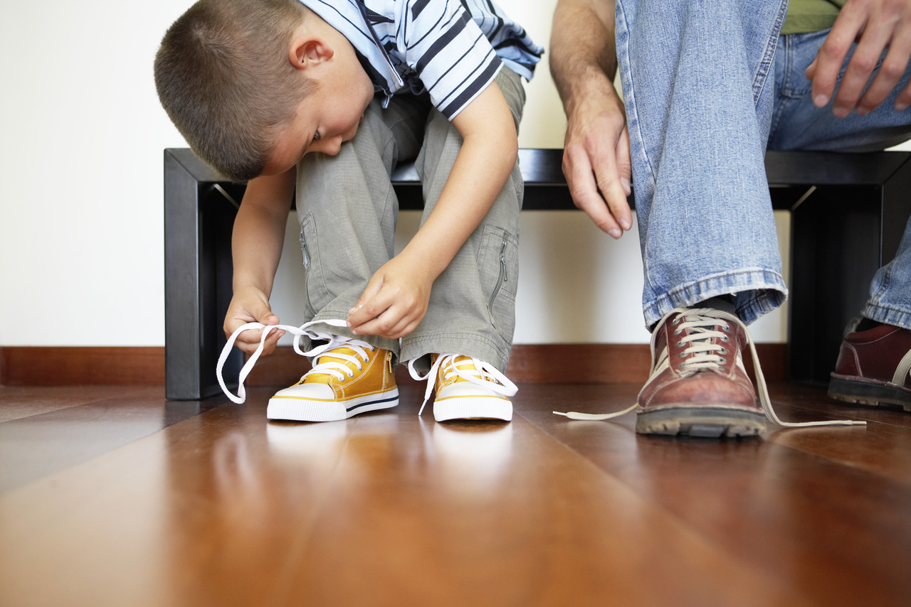 Little Boy Lacing his Shoes --- Image by © Royalty-Free/Corbis
